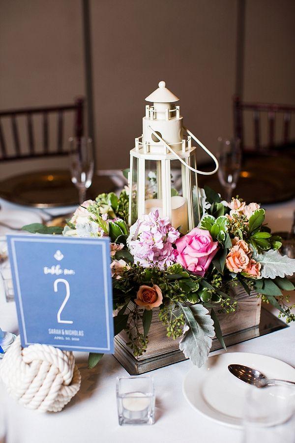 lighthouse lantern floral centerpiece leigh skaggs photography on tidewatertulle via aislesociety