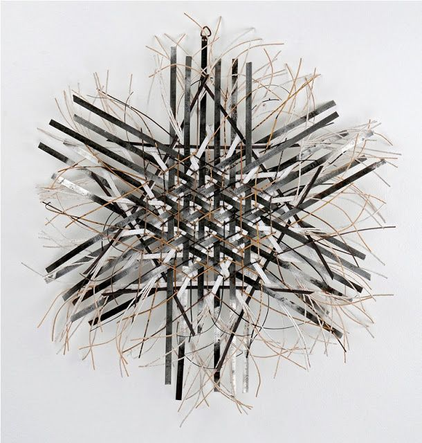 BLING / hexagonal plaited steel tape measures, dyed chair cane and spun paper -by Stella Harding