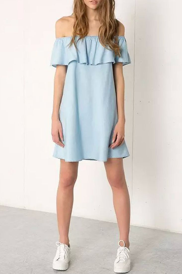 6f7b360aaf864 the dress crafted in denim. off-the-shoulder shoulder neckline with ruffled  overlay. high-low bottom.