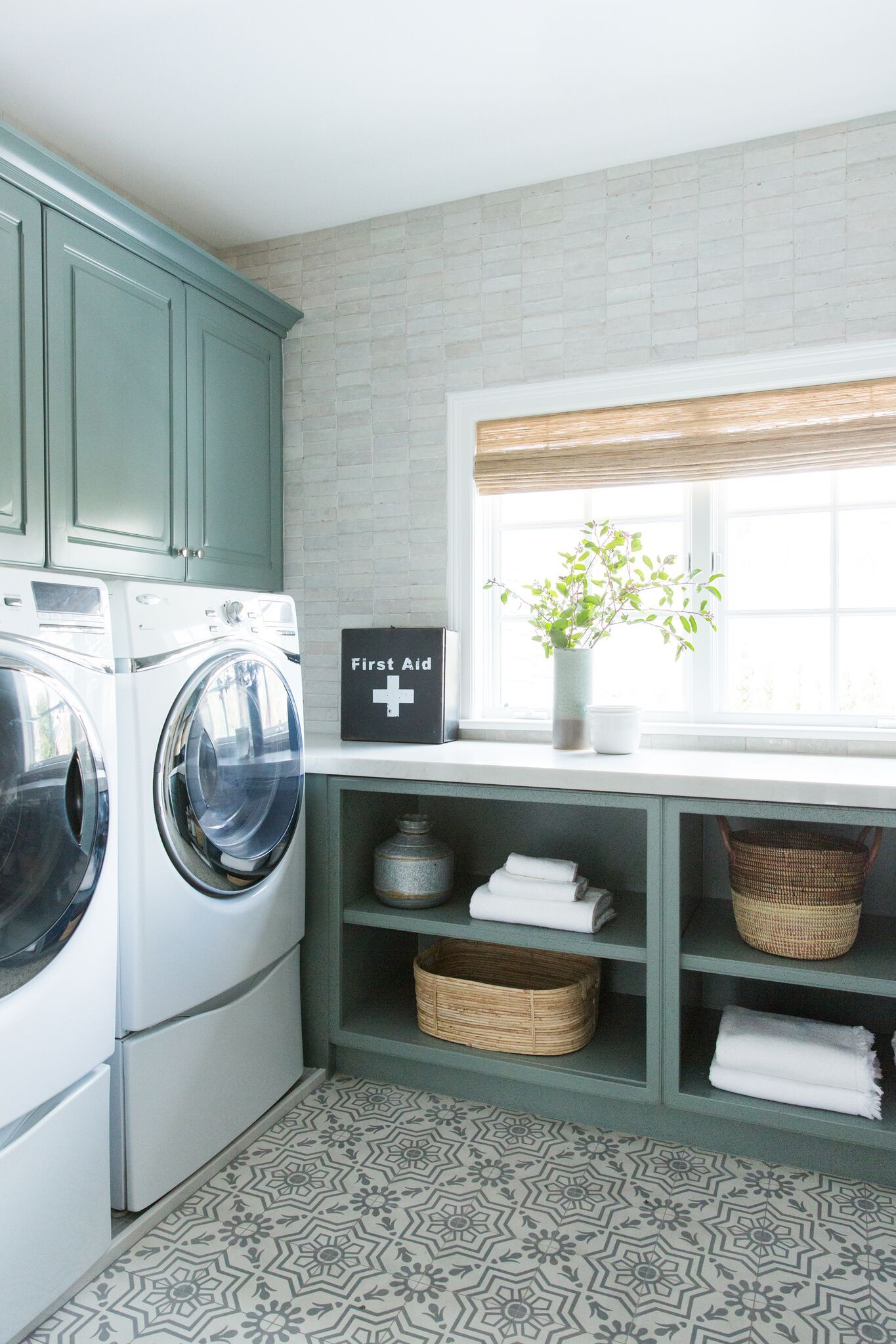 A new classic laundry room remodel with clay tiles green cabinets and patterned tile flooring studio mcgee blog