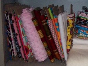 DIY fabric organizer. About $20 for pack of 100 comic book boards on Amazon.