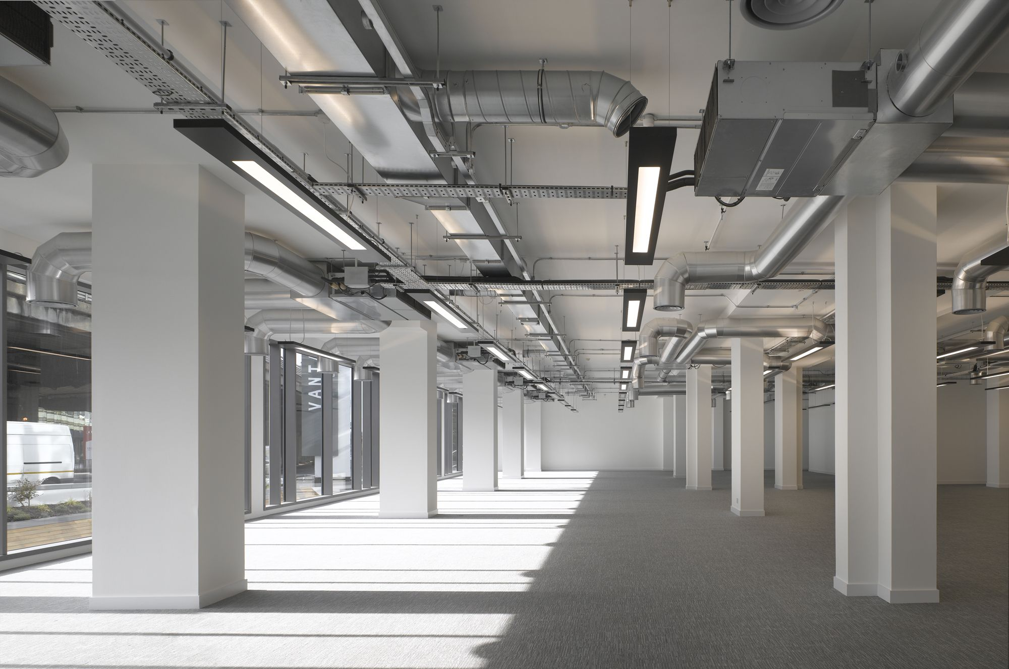 Commercial office space exposed services work spaces for Office interior decoration services