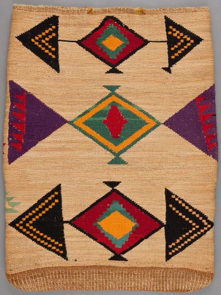A PLATEAU TWINED CORNHUSK BAG  c. 1900    false embroidered in bright shades of dyed commercial wool against a natural fiber ground, one side with geometric motifs, the other with serrated zigzag bands