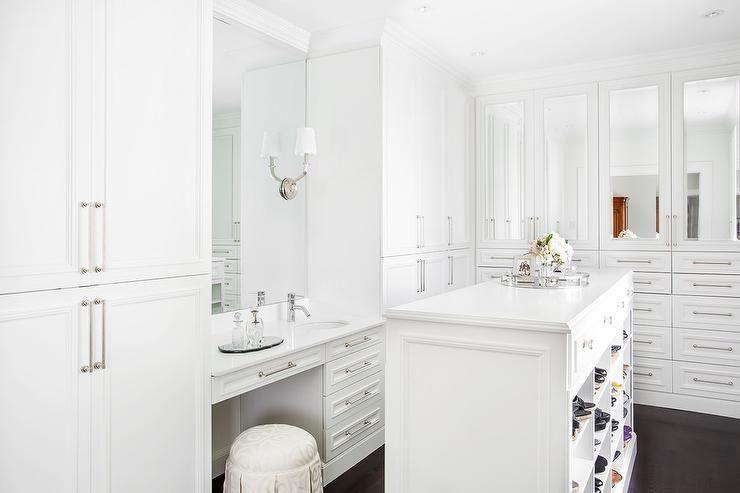 Monochromatic Custom Walk In Closet Features Ebony Wood Floors Framing A White Center Island Fitted With Shoe Dream Closet Design Closet Design Closet Designs