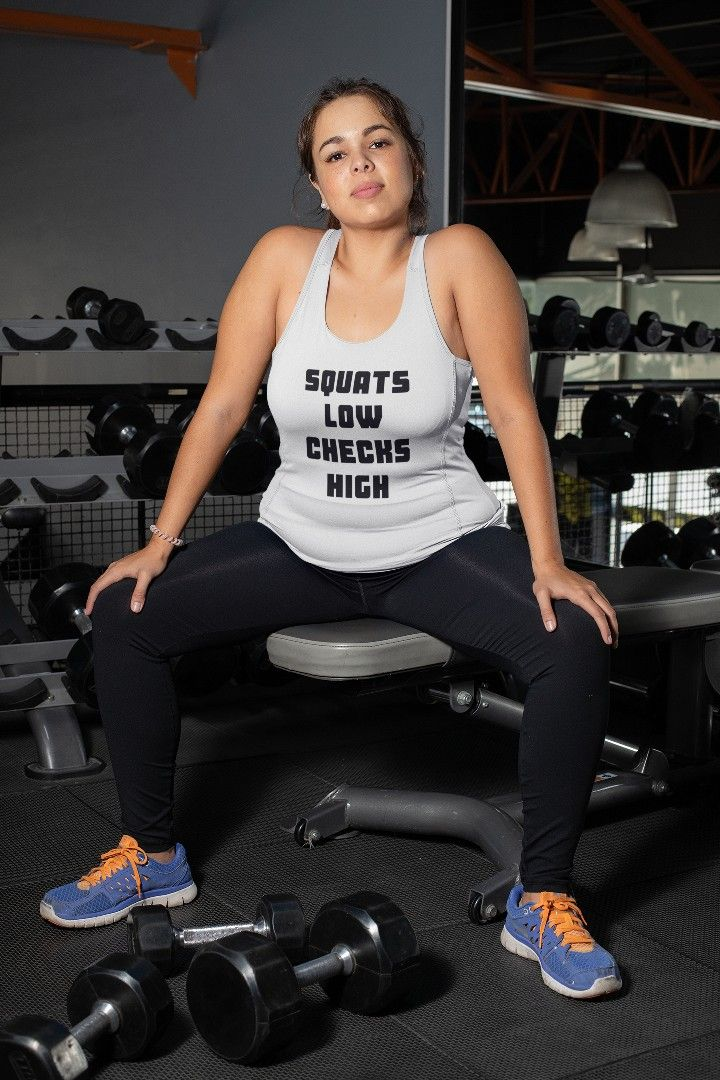 Squats Low Checks High Add some fun to your fitness wardrobe with this premium, funny unisex Squats