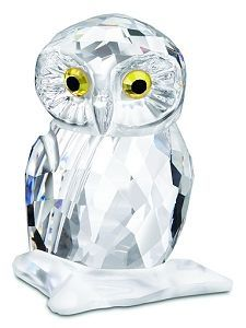 Swarovski Small Owl Presell signed This cute owl is the perfect gift for yourself or a loved one. In faceted clear crystal, its Light Topaz crystal and Jet crystal eyes sparkle with spirituality and innocence as it sits peacefully on a faceted mat clear crystal branch. This mini-masterpiece is a perfect example of Swarovski's evolution of design, innovation and craftsmanship.