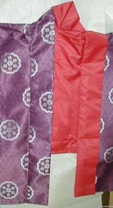 A kuragami in-progress, showing how the collar is made. The collar is then folded back to show the lining colour, and the triangle in the back lies flat.