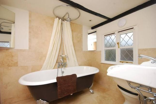 Create A Shower Out Of Your Freestanding Tub By Surrounding It