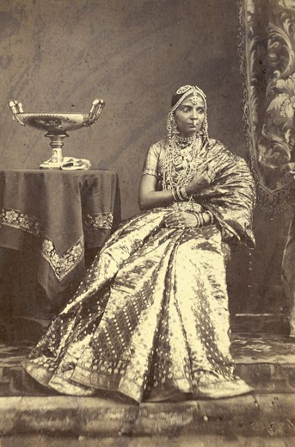 Portrait Of A Seated Girl Wearing Jewellery From Madras