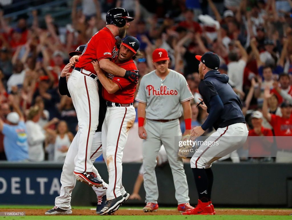 Brian Mccann Of The Atlanta Braves Reacts After Hitting A Walk Off With Images Atlanta Braves Brian Mccann Braves