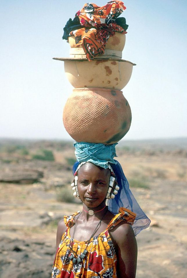 sculpture of african woman holding a container