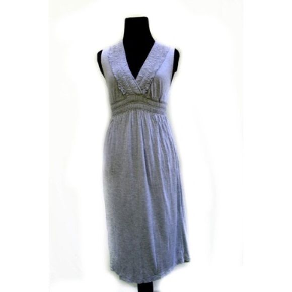 "J Crew Heather Gray Cotton Knit Sleeveless Dress A comfortable easy dress you will reach for on weekends, after work, beach or any time you want to be comfortable but more put together than a T shirt & shorts. Gathered detail on crossover neckline & under bust is stretchy. Dress itself is a stretchy knit. Measures 33"" bust, 36"" shoulder to hem. J. Crew Dresses"