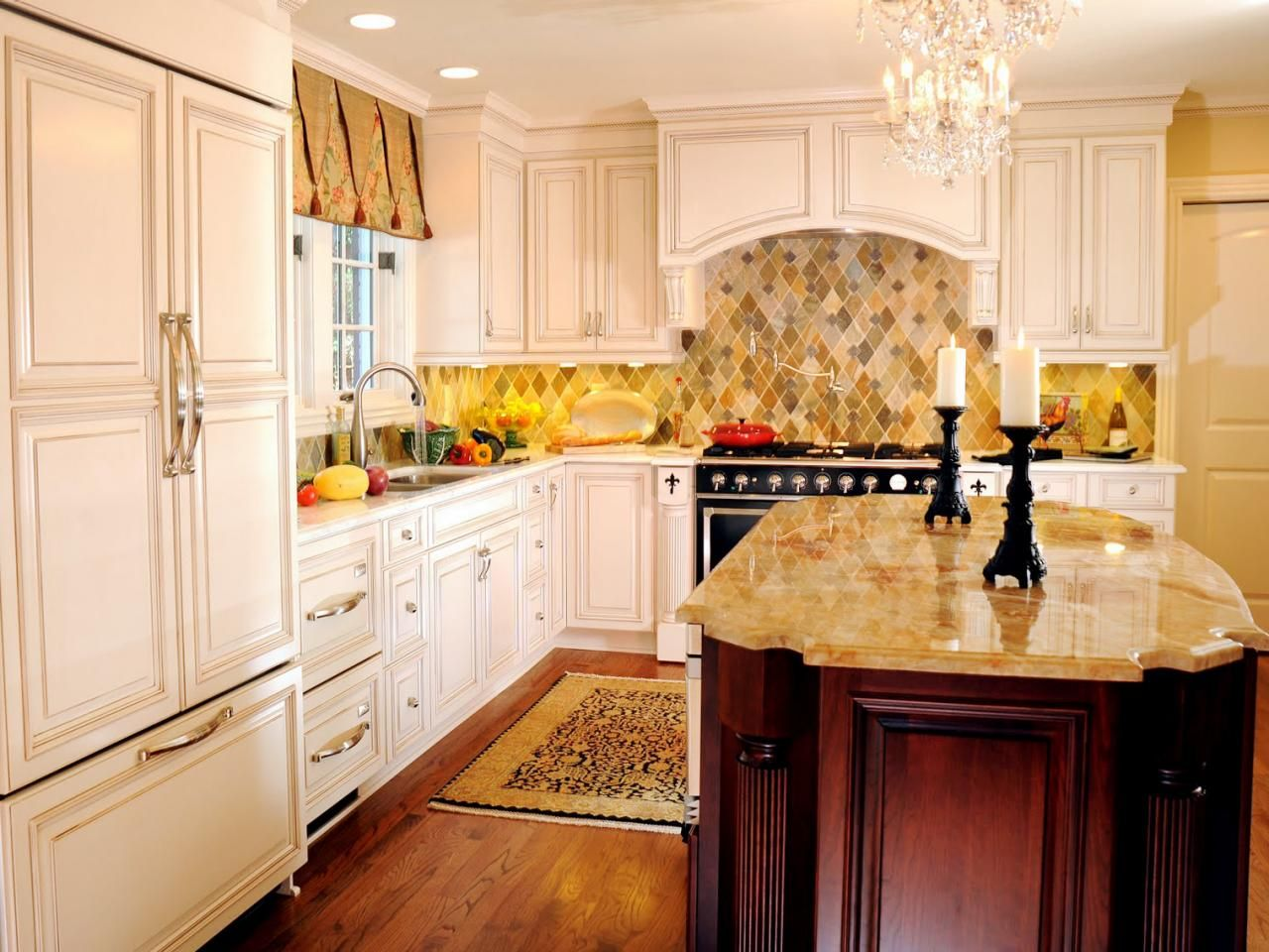 Pictures of kitchens with cream cabinets - This French Country Kitchen Designed By Katheryn Cowles Features Cream Painted Cabinets And A Granite