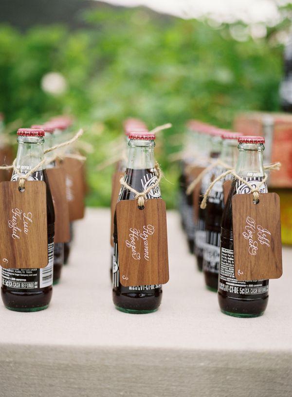 calligraphy escort cards on Coke bottles