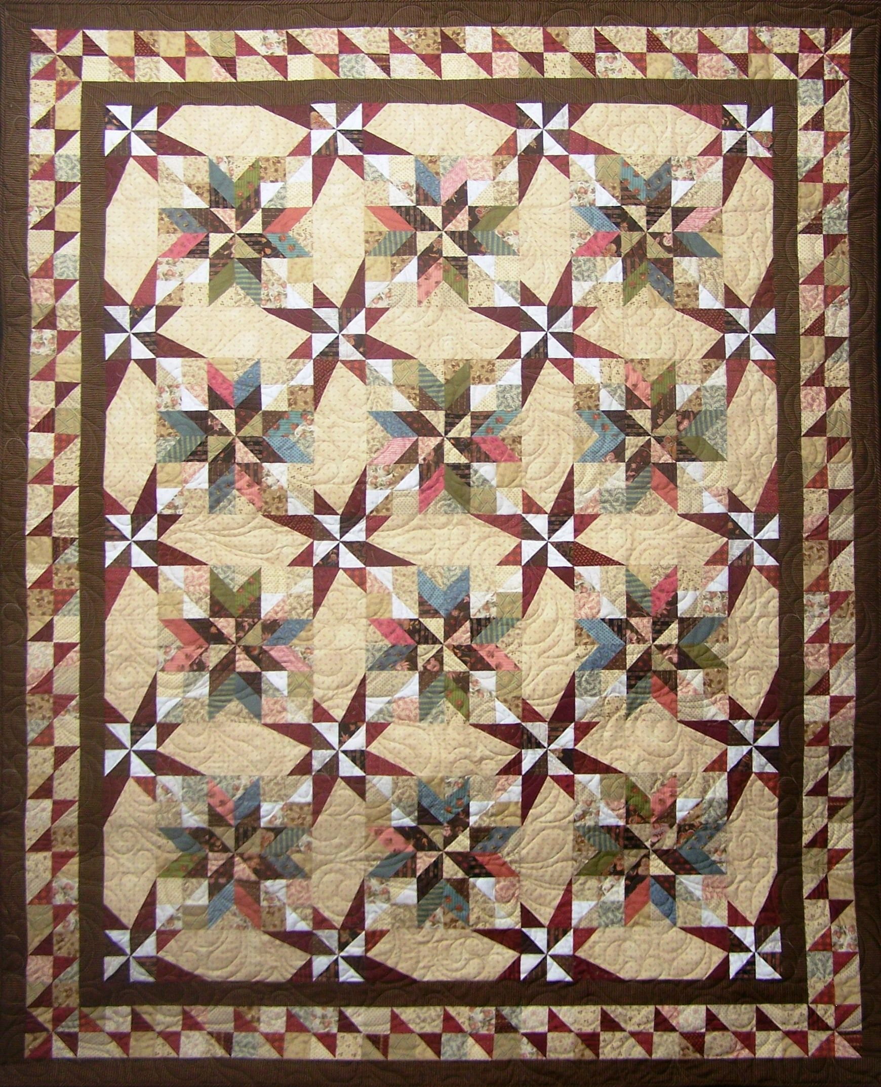 Very pretty. Whim Wham Stars. The asymmetrical star used in the sashing will make it appear that the stars are dancing across the quilt. Quilt may be completed with seven fabrics or may be scrapped using fat quarters. Size options: Small (52 x 68), Medium (68 x 84), Large (84 x 100) or XL (100 x 100). Recommended (optional) Tools: Perfect Corner Ruler™ by Forever in Stitches, LLC Tucker Trimmer 1™,