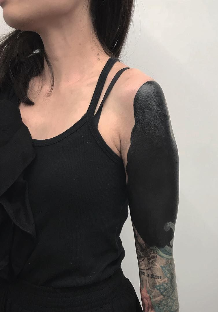 These Striking Solid Black Tattoos Will Make You Want To Go All In Black Sleeve Tattoo Solid Black Tattoo Black Tattoos