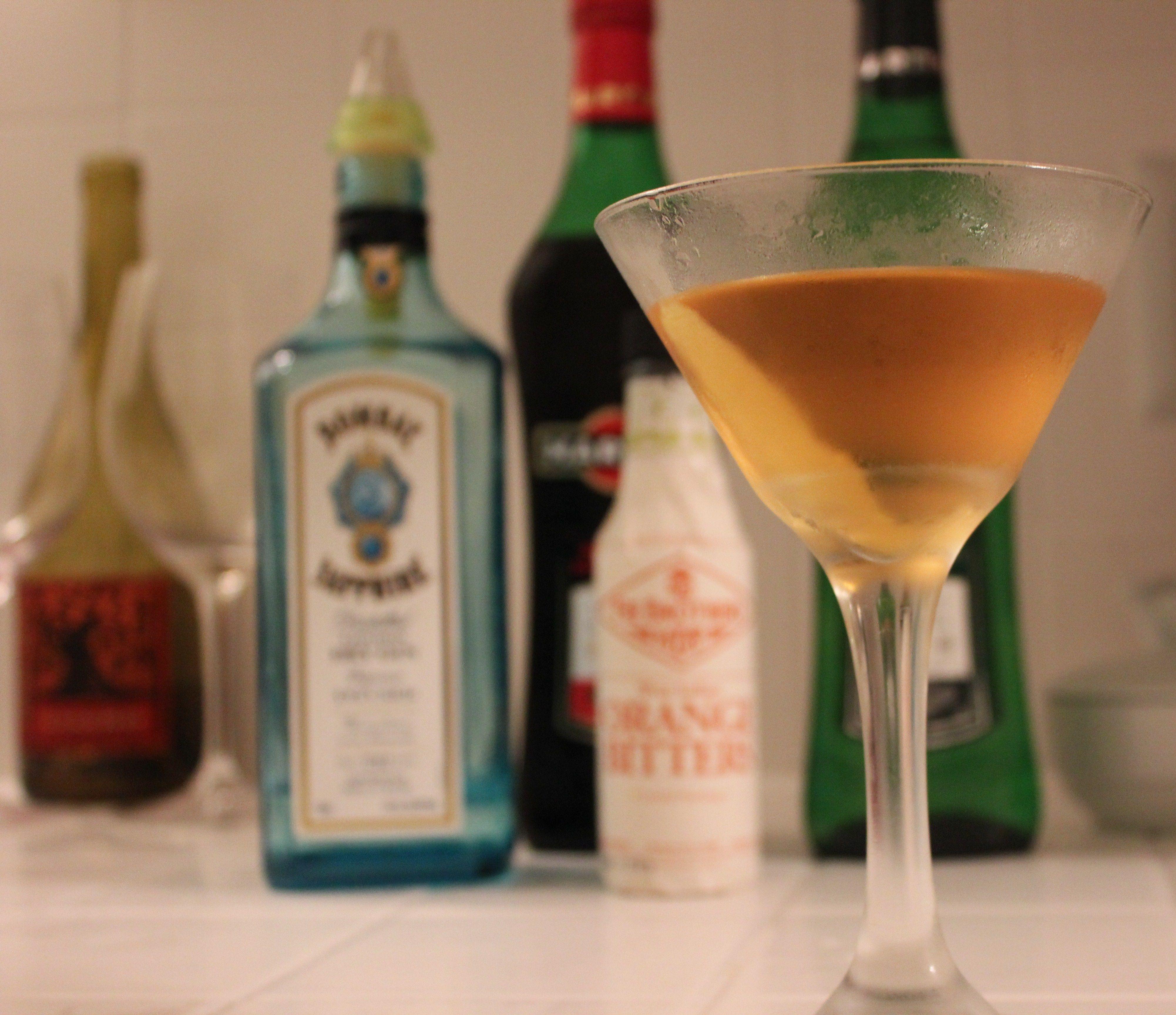 Martini, perfect.  2.25 oz gin,  0.5 oz sweet vermouth,  0.5 oz dry vermouth, Dash orange bitters    STIR, don't shake.