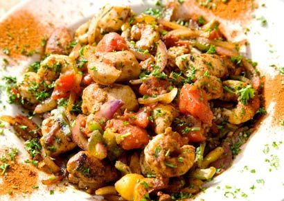 Curry-Spiced Seafood over Veggies and Rice:   Shrimp sautéed in curry, apple juice and soy sauce create a medley of flavors when served over a bed of onions, peppers, carrots, celery, and rice.  See the full recipe—and how to freeze it!
