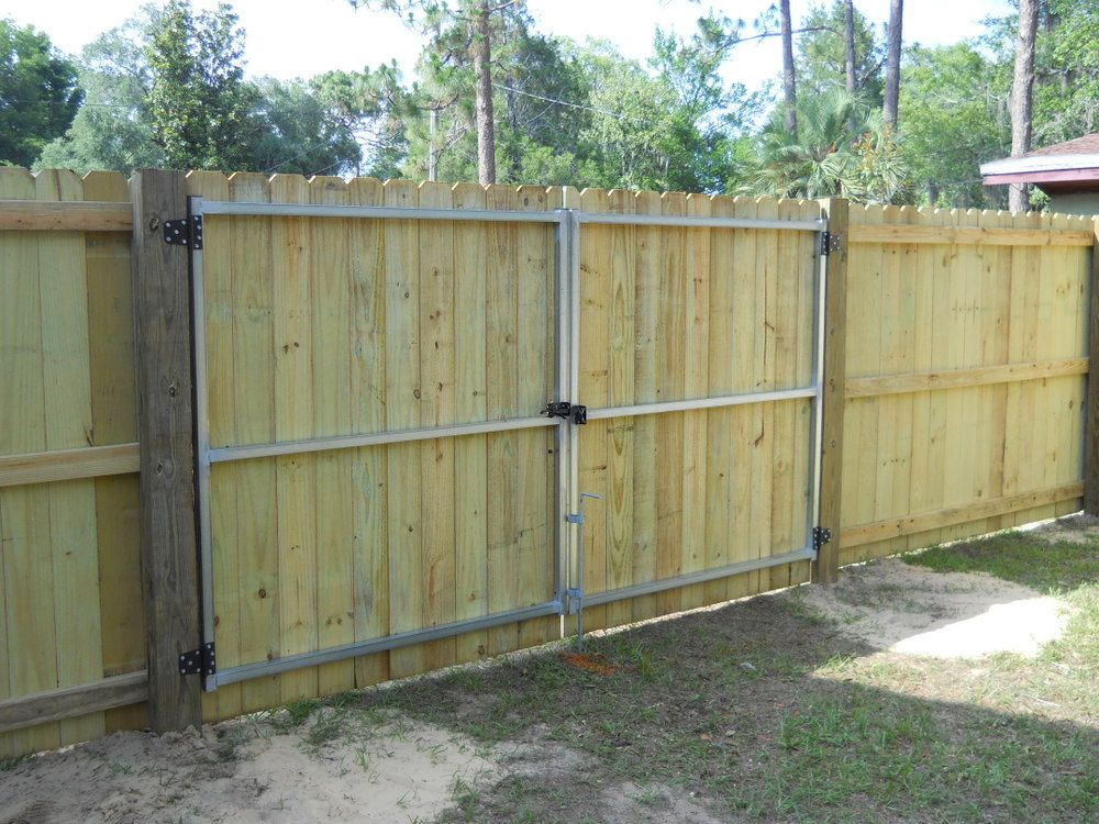 The Inside Of A Stockade Wood Privacy Fence And Double Gate Wood Fence Design Wooden Fence Gate Wood Privacy Fence
