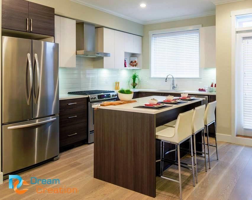 Modular kitchen with shaker cabinets and island kitchen with chairs ...