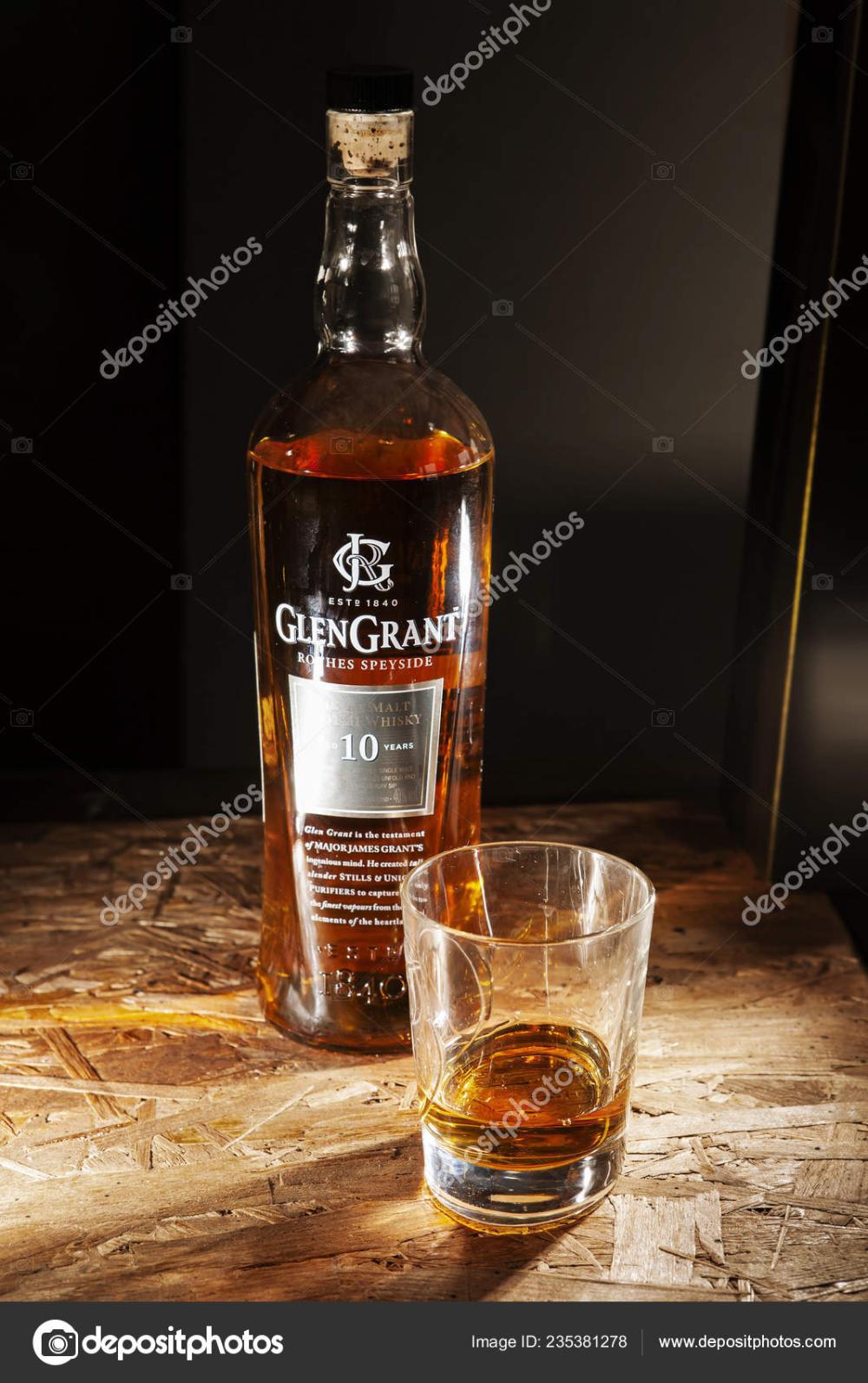 Download Lviv Ukraine December 04 Bottle Of Glen Grant Whisky And Glass On Wooden Shelf On December 04 2017 In Lviv Sto Grant Whisky Bottle Glen Grant
