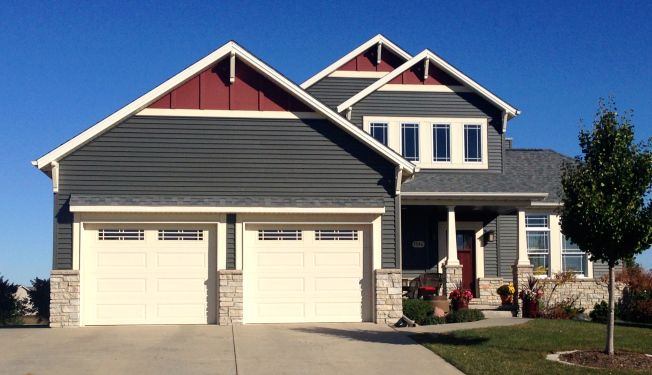 Dark Siding With Red Gable Accents Craftsman Style Home