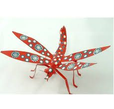 Image result for recycled tin can art