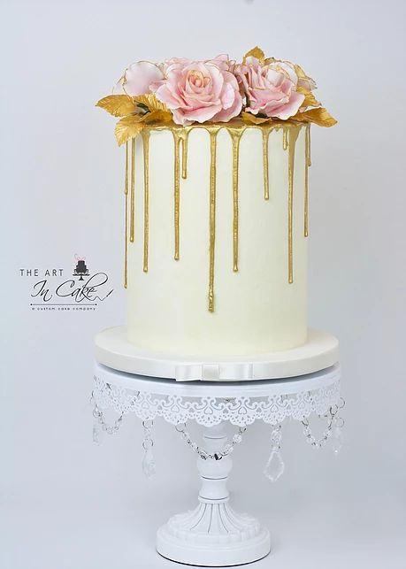 Gold Drip Bridal Shower or wedding cake with rose decorations on top ...
