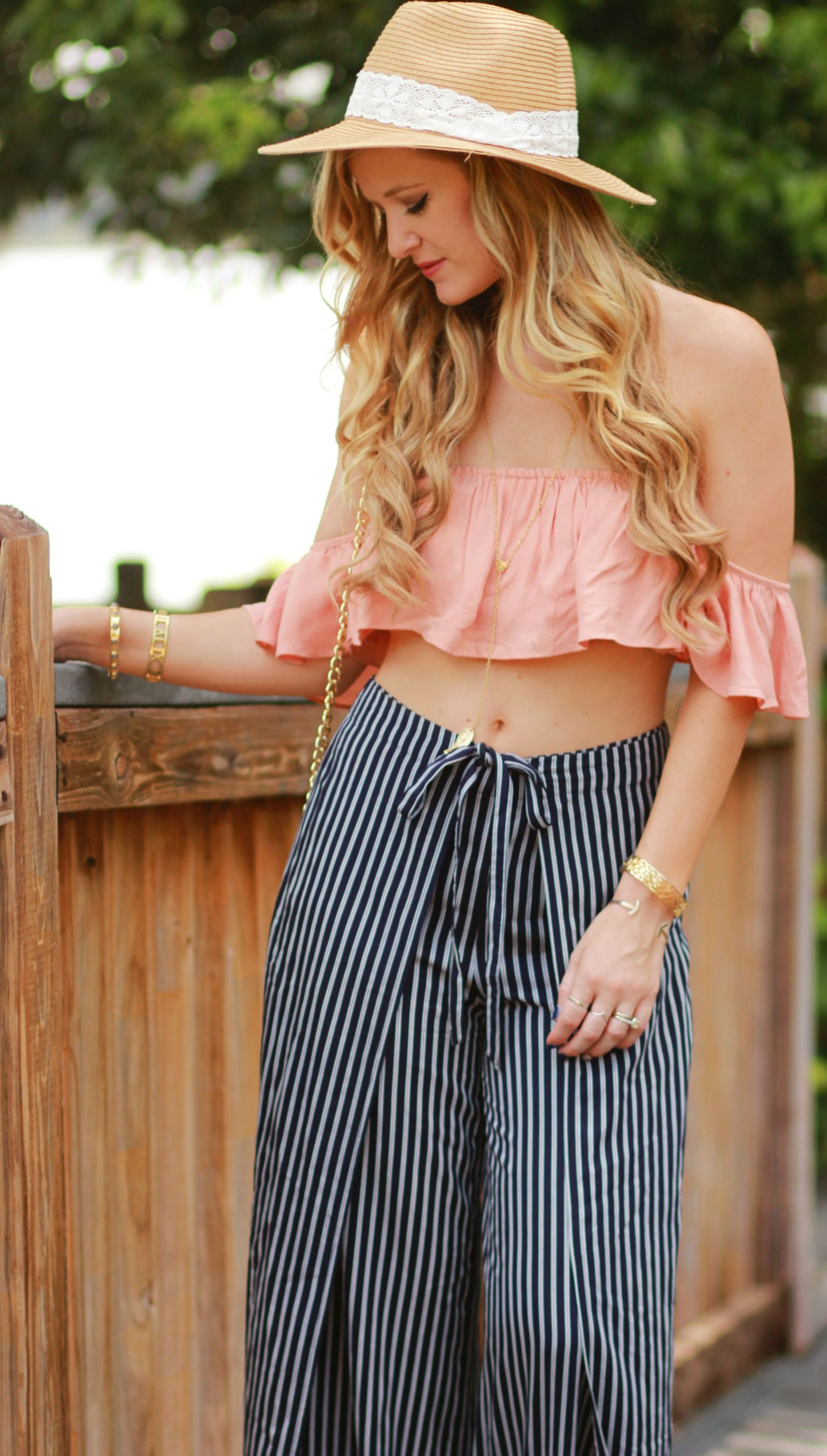 8e8ab164e2b5 Florida fashion blogger styles ruffle crop top with stripe wide leg pants  and straw hat for a casual summer vacation outfit