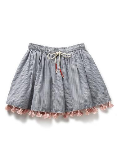 02825727a3 100% Cotton skirt trimmed with pink tassels. Elasticated waistband with  button trimmed ties.