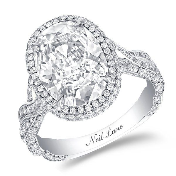 94608dfd0 An entwined diamond band sets apart this oval diamond halo ring by Neil Lane .