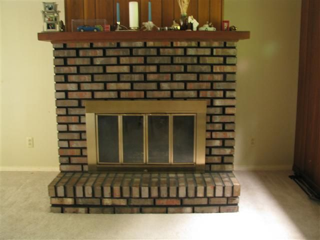BEFORE: Dated '70s brick fireplace with black grout and ...