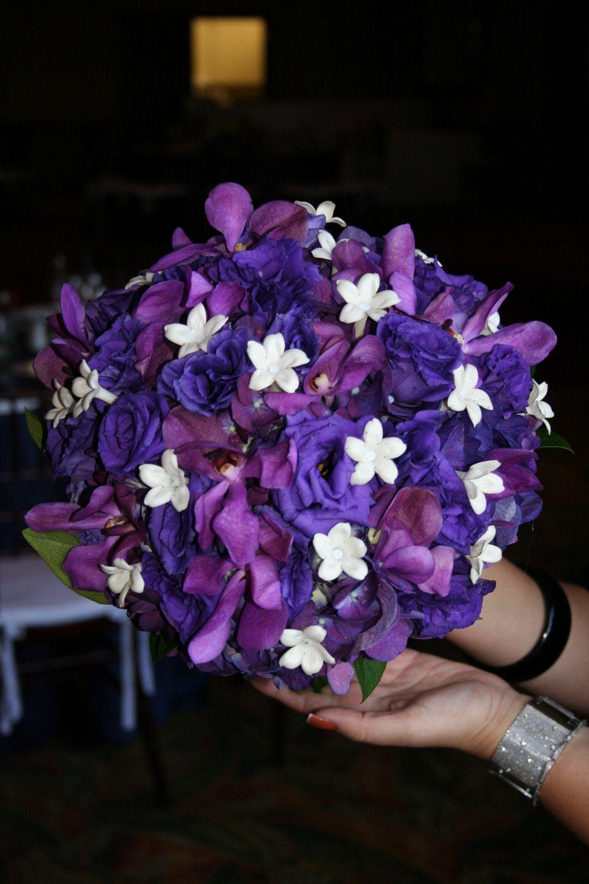 Purple bouquet with accents of stephanotis flowers by avant gardens purple bouquet with accents of stephanotis flowers by avant gardens miami izmirmasajfo