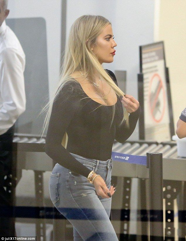 Khloe Kardashian puts her toned derriere on display in skintight jeans