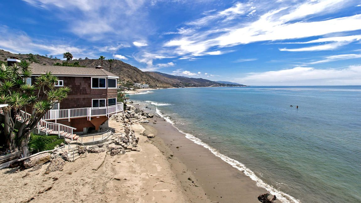 """The former home of actor Henry Gibson (who, among other things, appeared on """"Laugh-In"""" and voiced Wilbur the pig in """"Charlotte's Web"""") in Malibu is for sale for $6.9 million. The property encompasses three parcels along the beach!"""