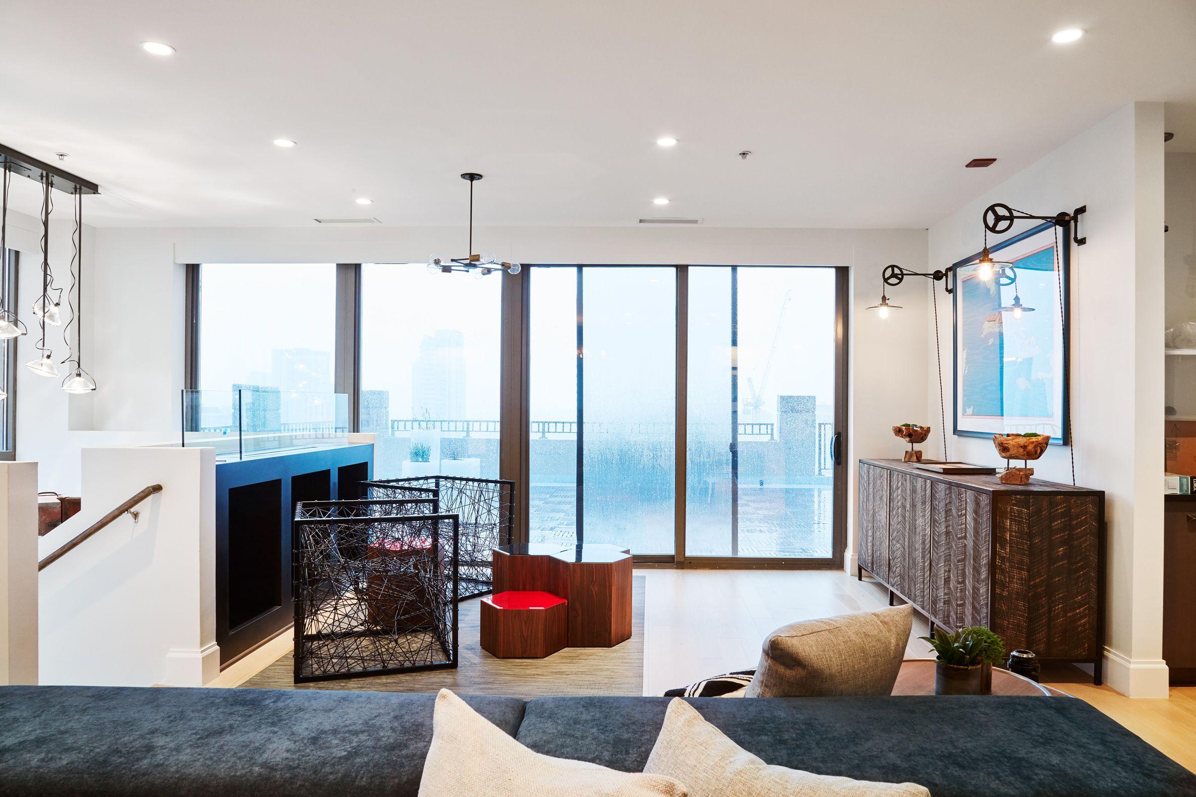 Industrial living room lighting - A Modern Industrial Condo In Chicago Industrial Living Roomsliving Room