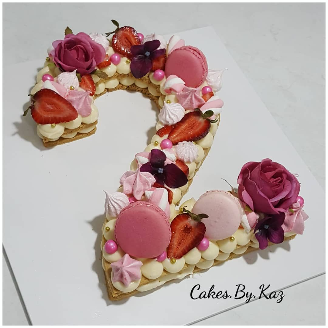 Cookie number cake with cream cheese frosting topped with