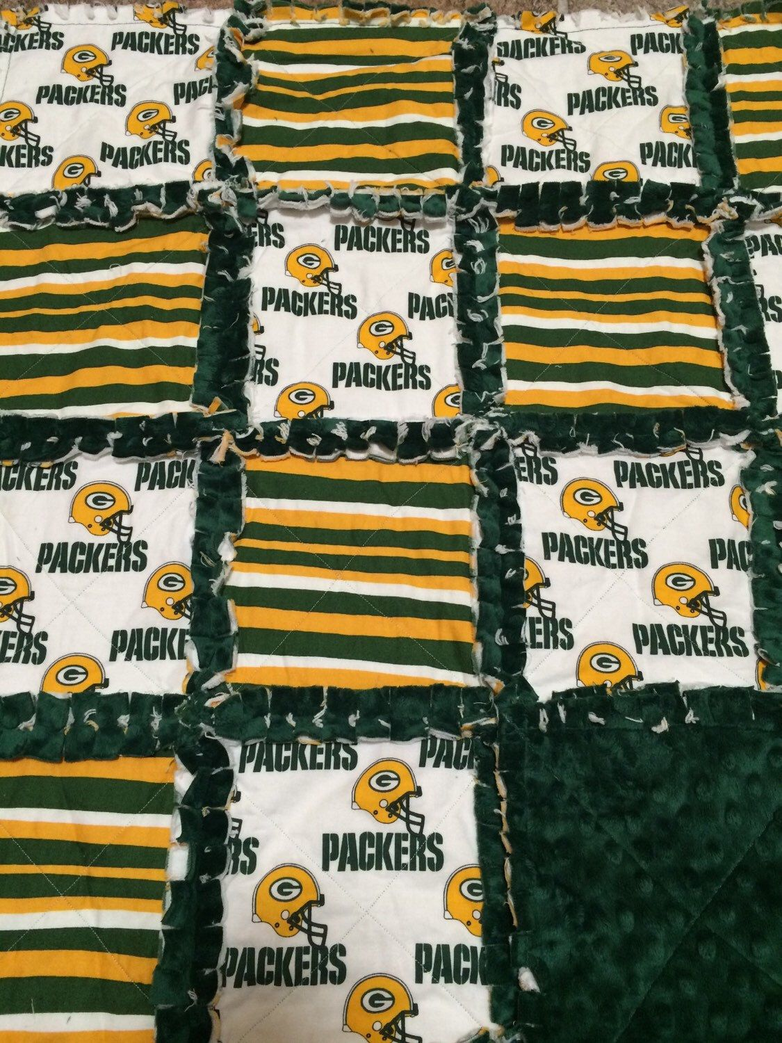 A personal favorite from my Etsy shop https://www.etsy.com/listing/252174020/green-bay-packers-rag-quilt