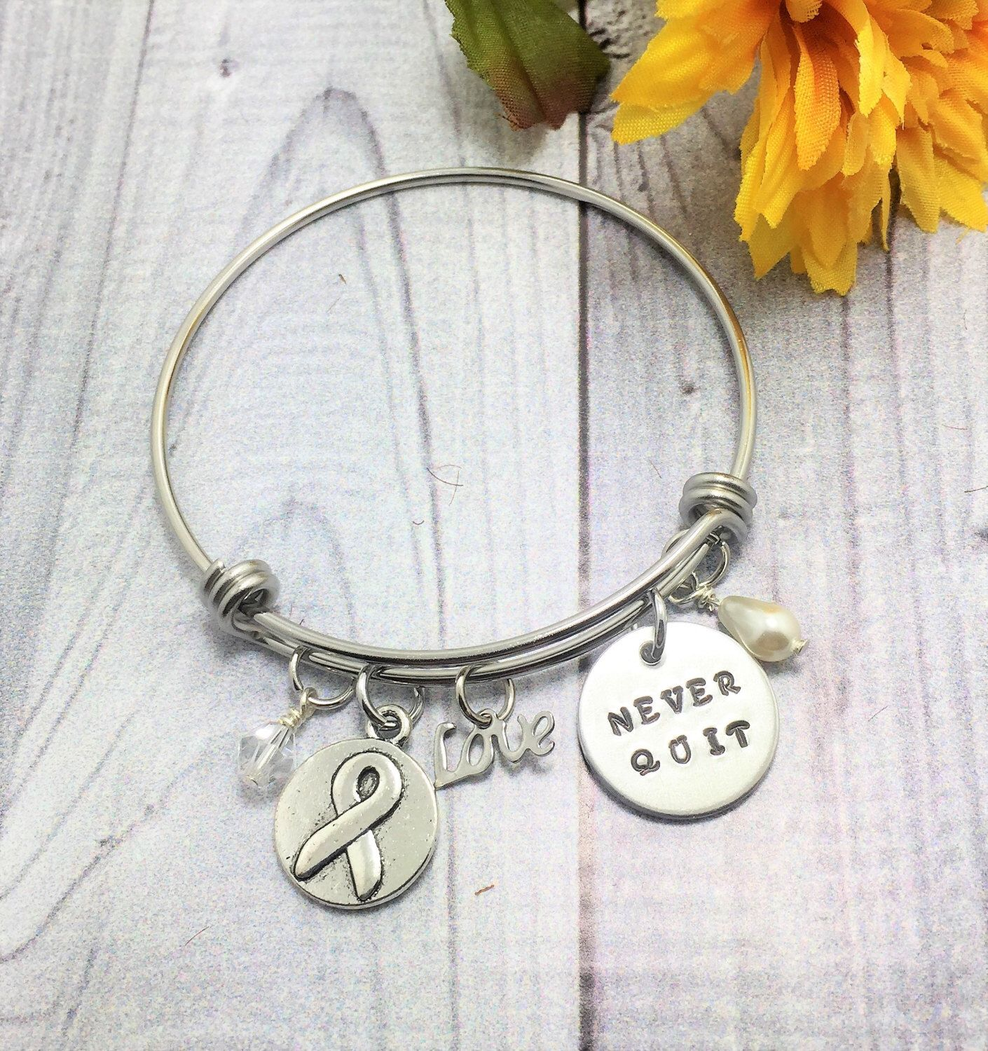 A personal favorite from my Etsy shop https://www.etsy.com/listing/479109274/charm-bracelet-cancer-awareness-hope