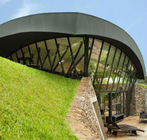 Modern earth shelter homes built into the hillside for Hillside architecture