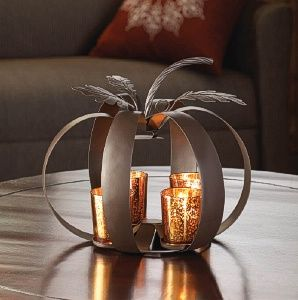 Four sparkling glass candle cups tuck neatly into this wrought iron pumpkin display. The candle cups are finished with an orange mercury glass design and nestle into the stylized pumpkin that features stem and leaf decorations to complete this festive autumn accent decor. http://www.wholesalemart.com/Wholesale-Candle-Holders-s/85.htm
