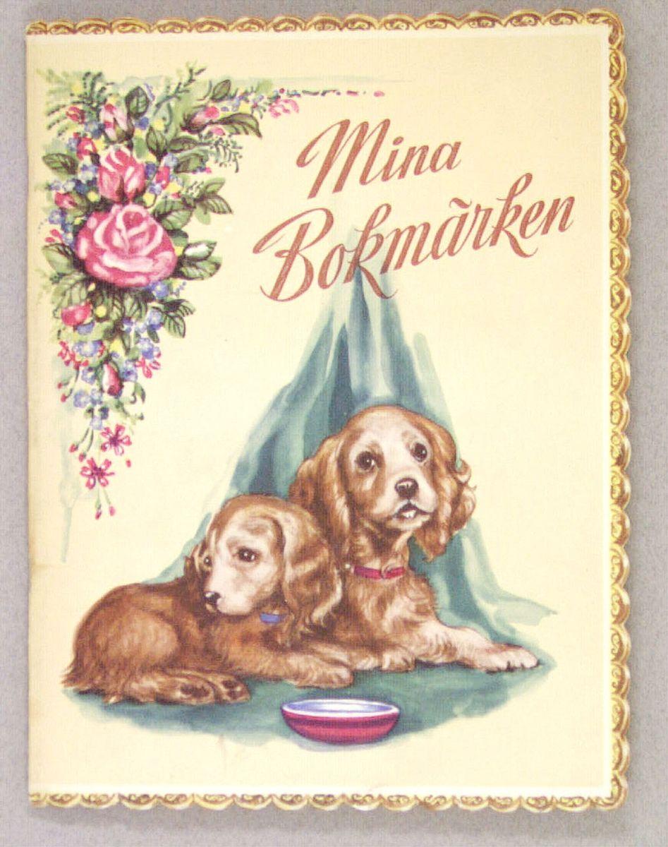 Ett bokmärksalbum med inklistrade bokmärken på framsidan två hundar