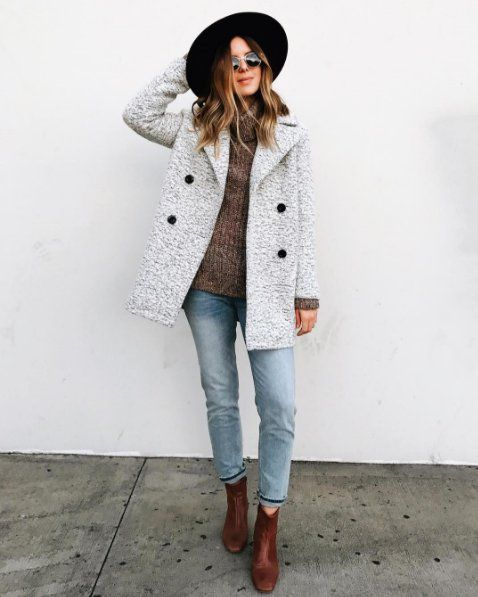 A waistcoat with a chunky sweater, jeans and ankle boots.