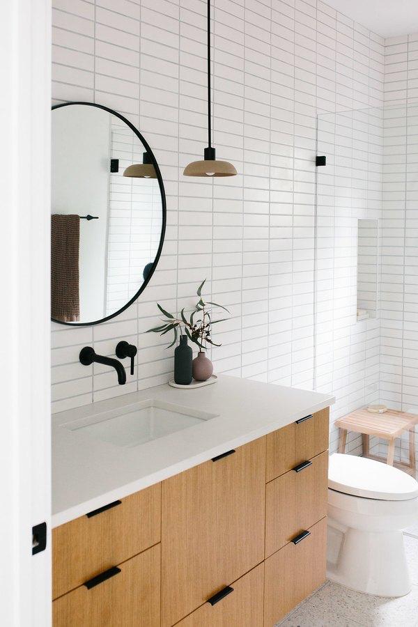 10 Soothing Scandinavian Bathroom Ideas Hunker Scandinavian Bathroom Bathroom Mirror Bathroom Interior