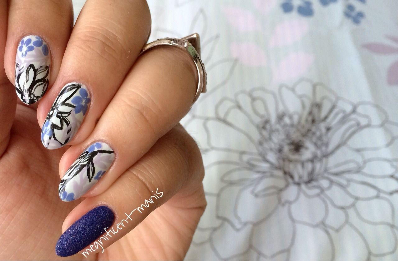 Hello, friends!  I apologize for the MAJOR lack of posts. I'm doing my best to share some nail art as much as possible. This week I have a freehand floral mani (YES, another one)!  This matches my bedding! Blue and florals - two of my favorite things. Three, if you count a fresh mani/some nail art.  Colors used: Moon Baby by Floss Gloss (base) Megan by Zoya (take a guess why I own this bottle. Ha!) Secret Peri-winkle by China Glaze Blue Persuasion by SinfulColors (it's a texture!) Black…