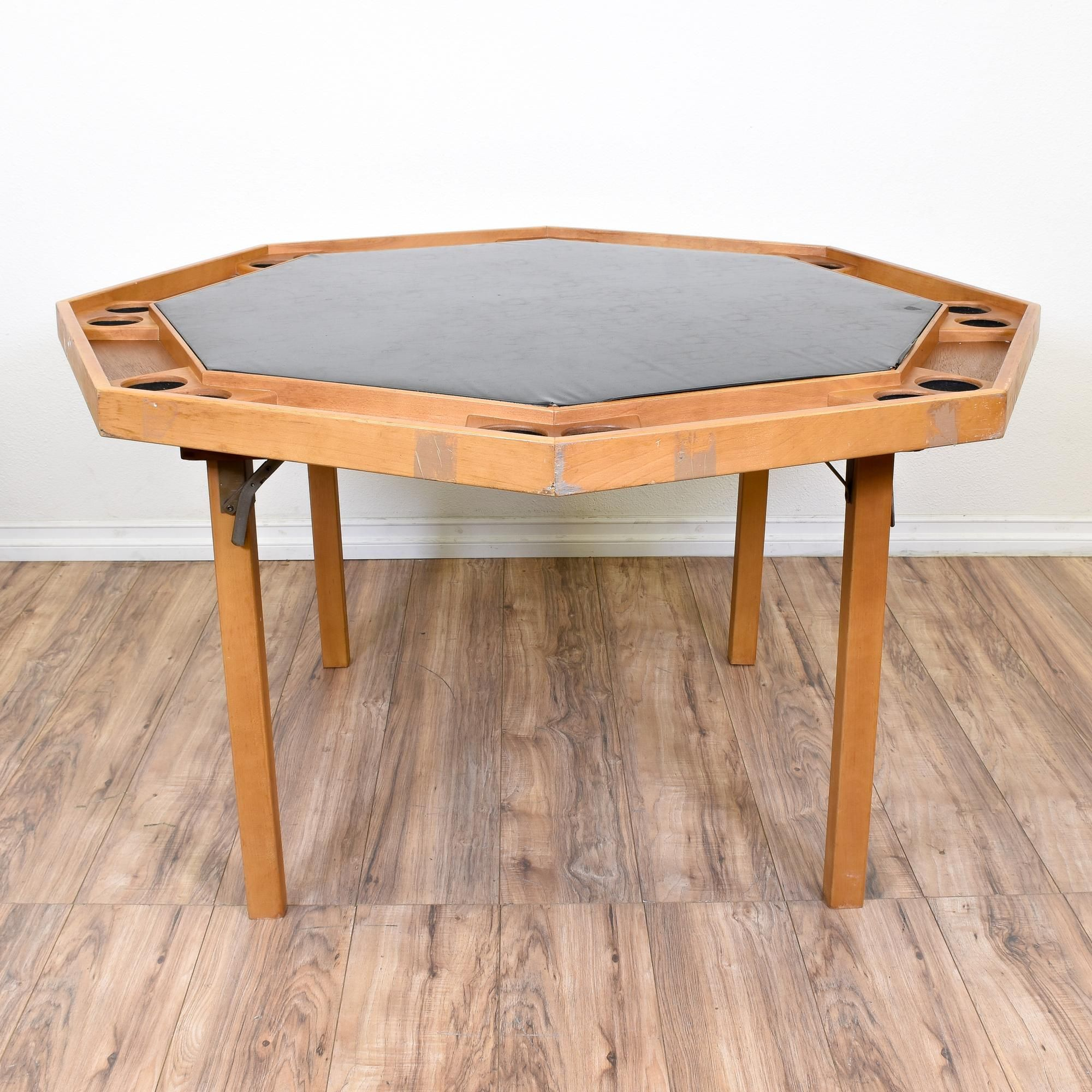 This folding game table is featured in a solid wood with a raw