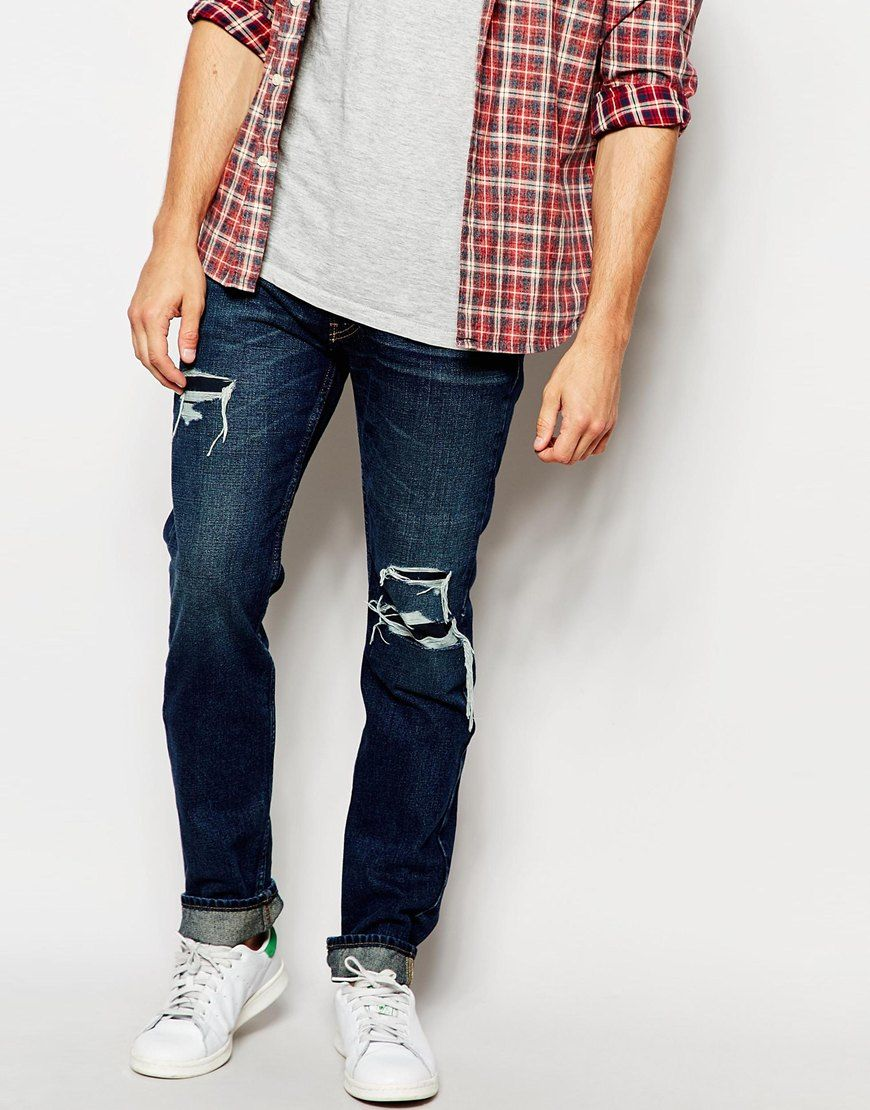 Skinny jeans by Hollister Non-stretch denim Dark wash Zip fly Five pockets  Destroyed wash Skinny fit - cut closely to the body Machine wash Cotton Our  model ...