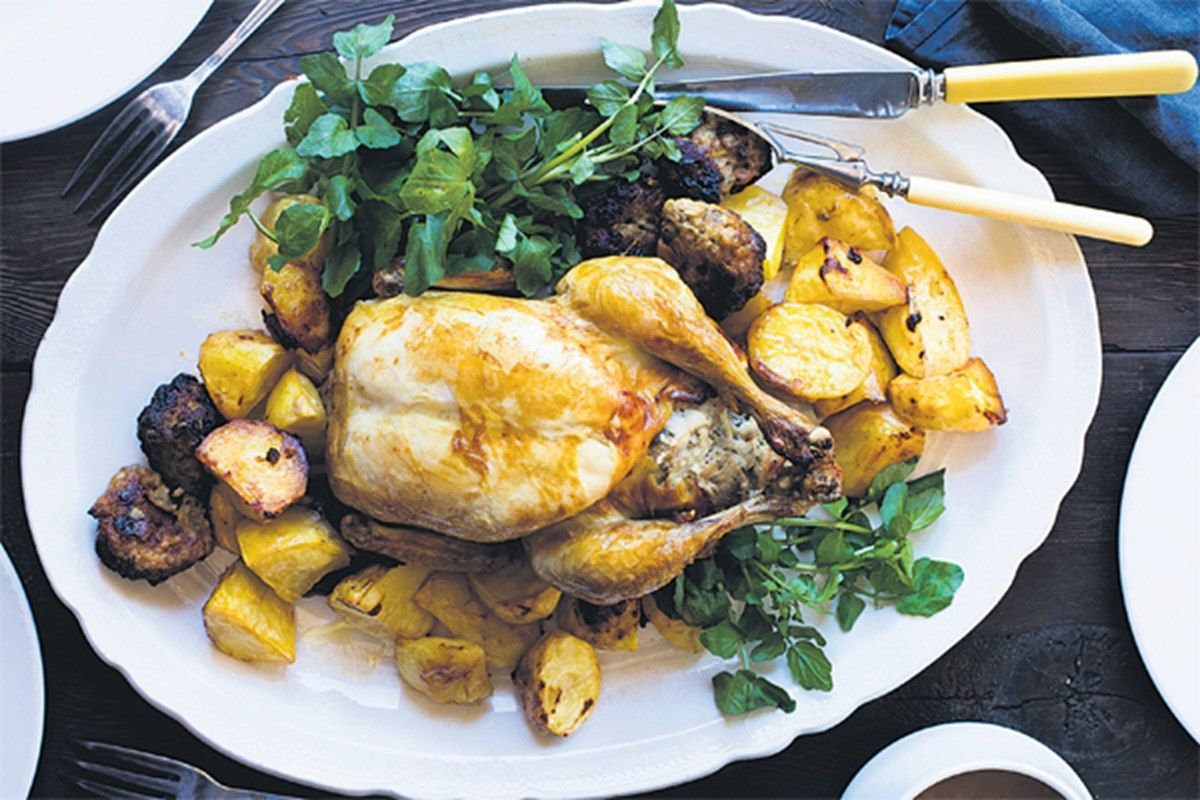 Chicken stuffed with pork and roasted with potatoes ...