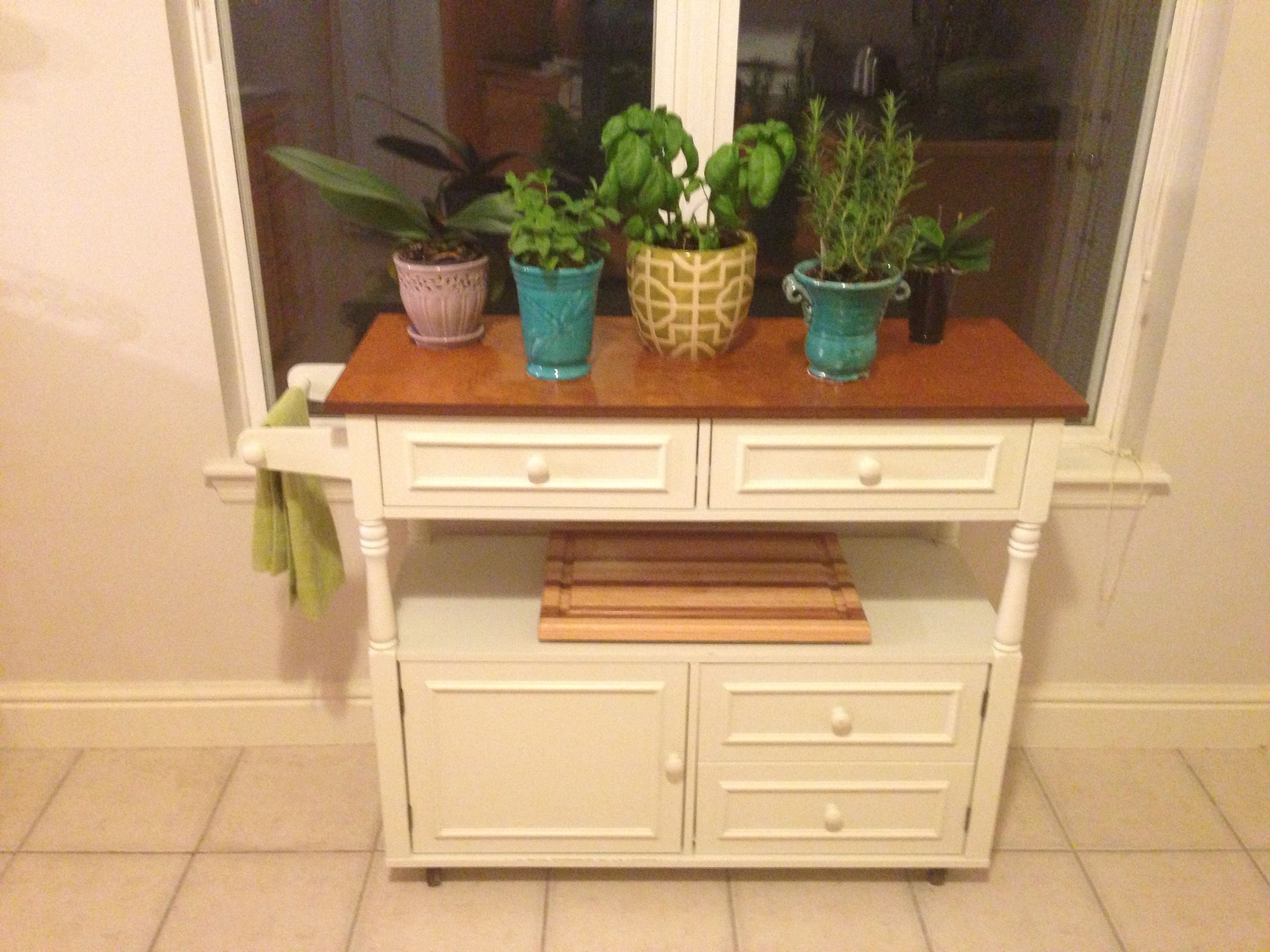 Spice up an old kitchen hutch by turning it into an herb table with