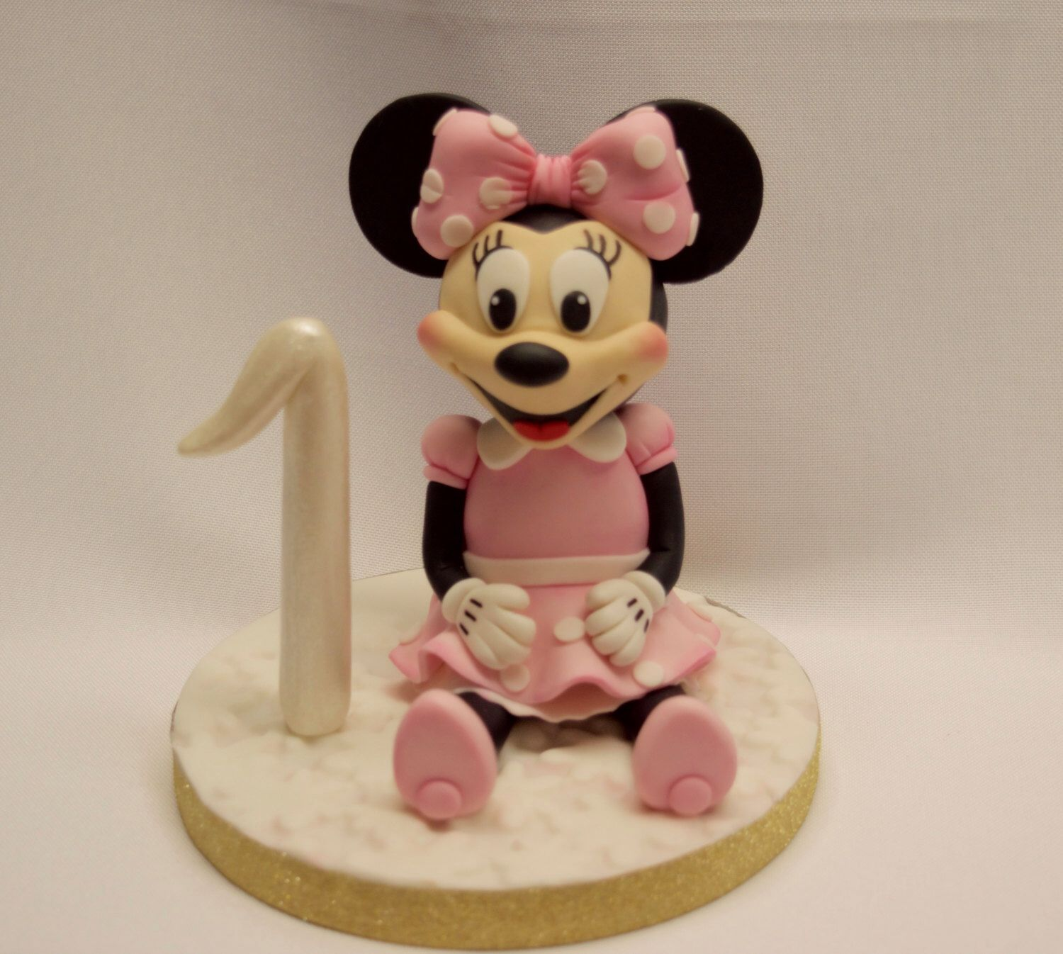 A personal favorite from my Etsy shop https://www.etsy.com/listing/470070729/minnie-mouse-cake-topper